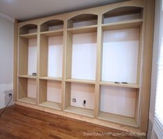 Built in bookshelves for library. Would put doors at bottom, open shelving above with curved detail at top.