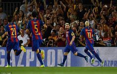 Barcelona players race to celebrate Messi's opening goal as the home supporters…