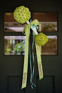 SOOO want to do this for the front door!  Green rattle, purple ribbon with her name Aleeya Jean :)