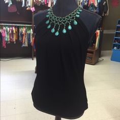 ❤️❤️Beautiful Marciano Blouse❤️❤️ I love this shirt!! The turquoise neck already provides a necklace  This is a Marciano, but the tags have been removed. Marciano Tops Blouses