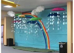 cool rainbow bulletin board w/ hanging 3D clouds, raindrops and umbrellas- this would...