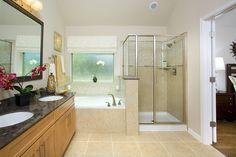 Gehan Homes Master Bathroom - Tan tile, black granite countertops, wood cabinet, brushed nickel hardware, orchid. San Antonio   Alamo Ranch - The Summit - Laurel #Gehanhomes