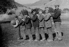Calabasas schoolboys posing in a line, circa 1920s. Left to Right: Percy Massen, Fred Tucker, Frank Cooper, Walt Penland, Joe Lee, Stanley Massen, Jerry Grant.  Calabasas Historical Society. San Fernando Valley History Digital Library.
