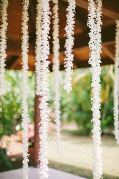 Hanging flower garland. Photography by Rebecca Arthurs | rebecca-arthurs.com, Event Planning by Vintage & Lace | vintageandlace.com | Read more - http://www.stylemepretty.com/2013/06/13/hawaii-wedding-from-rebecca-arthurs/