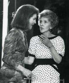 Jacqueline Kennedy Onassis chats with First Lady Nancy Reagan at a fundraiser for the John F. Kennedy Memorial Library at Sen. Edward Kennedy's home in McLean, Virginia on June 24, 1985