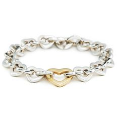 ✨SALE✨Tiffany heart link bracelet. Silver/18k gold  Tiffany heart link bracelet with silver and 18k gold. Beautiful bracelet. Excellent condition. This bracelet is no longer sold on Tiffany's website, and as such makes it more of a collectors item. Therefore, though the price is negotiable (as always), it will be much less negotiable than other items. More pics will be posted as soon as I get the chance/upon request!!  Tiffany & Co. Jewelry Bracelets