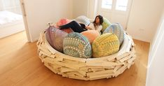Designers Merav Salush Eitan and Gaston Zahr from OGE CreativeGroup created this cozy and comfy-looking space for socializing, playing, informal meetings, or simply lounging. The Giant Birdnest is made of lacquered pine wood planks and is filled with soft cotton-lycra egg-shaped cushions.
