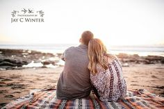 Warm sunset engagement photo, blanket on the beach, watching the sunset. | San Luis Obispo Wedding Photographer Jay C Winter » Award Winning Destination Wedding Photographer