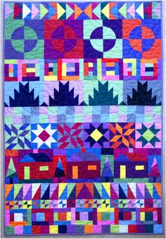 Shott in the Dark row quilt by Anne Williams (36 x 54in); made in Oakshott cottons.  Long-arm quilted by The Bramble Patch.  This was a 2014 mystery quilt published in The Quilter magazine.