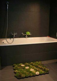 green moss growing on unusual bathroom mat