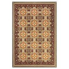 Indoor/outdoor rug in sand and terracotta with a floral motif.  Product: RugConstruction Material: PolypropyleneColor: Sand and terracottaFeatures: Suitable for indoor and outdoor use Note: Please be aware that actual colors may vary from those shown on your screen. Accent rugs may also not show the entire pattern that the corresponding area rugs have.Cleaning and Care: Vacuum on hard floor setting