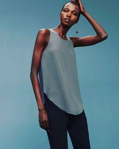 In case you were wondering what universally flattering looks like. This is a sleeveless blouse with a sculpted hem and an exposed metal zipper at the back. It's made with a luxe Japanese fabric that drapes nicely. Short Sleeve Blouse, Sleeveless Blouse, Japanese Fabric, Blouses For Women, Athletic Tank Tops, My Style, Mens Tops, Clothes, Models