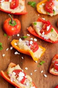 Healthy Hummus Stuffed Peppers - hummus of choice, sweet mini/sliced bell peppers, red onion, grape tomatoes, fresh parsley, crumbled feta cheese, optional toppings (olive oil, balsamic vinegar)
