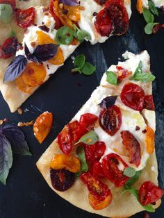 Thin Crust Burrata Pizza Pie Slice with Roasted Cherry Tomatoes and Basil