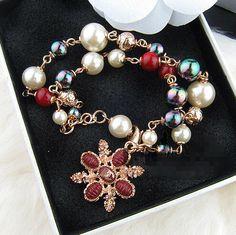 Chanel color pearl cross bracelet