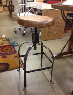 Industrial Bar Stool. Cost Plus World Market $109  I would like these for the kitchen.  The heighth is adjustable.