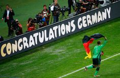 Manuel Neuer of Germany celebrates with a German flag after defeating Argentina 1-0 in extra time during the 2014 FIFA World Cup Brazil Final match between Germany and Argentina at Maracana on July 13, 2014 in Rio de Janeiro, Brazil.