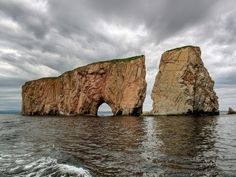 This 1420-foot limestone colossus is one of the world's largest natural arches. Looming in the middle of the pristine Gulf of St. Lawrence, it's a spectacular sight. A 75-minute boat ride from the village of Perce will take you there.