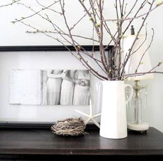 Fresh cut branches and a small nest sitting on the table