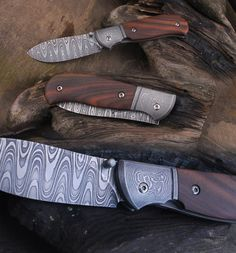 Dohnal knives. linerlock. Damascus blade, handle Damascus and santos rosewood, titanium