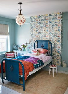 Creative Kids' Spaces that Capture the Imagination: In Jen Albano's Brooklyn townhouse, Arts and Crafts wallpaper creates an unexpected accent wall for daughter Esme Bloom. An indigo-dyed coverlet is the perfect complement.