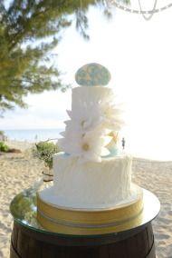 Rustic Chic Grand Cayman Wedding - Style Me Pretty. Wedding Cake on Seven Mile Beach. Wedding design by Celebrations Ltd. Grand Cayman.