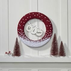 DIY Christmas Wreaths, like this Let It Snow Wreath from Floracraft, are the perfect way to put a personal touch into your holiday decorations. This wreath is made of sturdy craft foam, making it perfect to decorate your door for the holidays. The whimsical design is sure to spread holiday cheer all season long! The use of silver sequins as falling snow gives this wreath a sparkle that will really make your door stand out to guests. This easy DIY wreath is a great alternative to the typical…