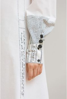 Embroidered sleeve detail with words & dots; creative fashion design detail // Lemaire- ooooh wouldn't it be cool to sew a garment then embroider all the pattern instruction on the garment itself- like an art piece Look Fashion, Fashion Details, Fashion Art, Trendy Fashion, Womens Fashion, Fashion Trends, Dress Fashion, 70s Fashion, Jeans Fashion
