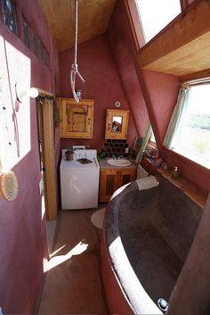 Modular Earthship tub and laundry