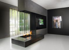 A unique and beautifully designed, modern double sided fireplace shown here as an extension of a separating wall. Its a beautiful double sided fireplace and a wonderful feature. Double Sided Gas Fireplace, Open Fireplace, Living Room With Fireplace, Fireplace Design, Fireplace Glass, Fireplace Modern, Fireplace Pictures, Fireplace Garden, Fireplace Ideas