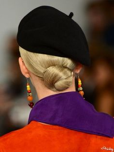 It's no surprise this hairdo was seen at Ralph Lauren's spring 2013 show since it's the ultimate in understated elegance—and if this is your bun of preference, then so are you. Just part hair down the middle, slick back into a low ponytail, and twist into a bun, securing with bobby pins. The chignon should sit right at the nape of your neck so you're able to accommodate a preppy hat.