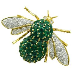 Emerald Diamond Gold Bee Brooch | From a unique collection of vintage brooches at https://www.1stdibs.com/jewelry/brooches/brooches/