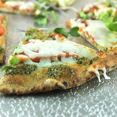 Fresh basil best tops whole wheat flatbread for a quick and satisfying meal. Perfect for using up the last of your summer basil crop.