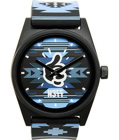 The Neff x Mac Miller collaboration continues with the Daily Maclock watch in the all over blue and black native print. This analog N377 watch has a cyan blue and black native print PU adjustable band and face plus a Miller thumbs up logo right in the mid