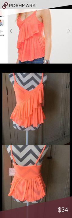 Free People Melborne Frill Tank Brand new neon coral tank by Free People. Ruffle front. Color is called pink but is more orange/coral. Adjustable straps. Free People Tops