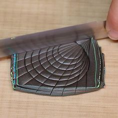 The new metallic Liquid Sculpeys are perfect for creating your bezels in our bakeable bezel molds! Design by Amy Koranek Getting Started: Polymer clay may stain. CLAY MAY DAMAGE UNPROTECTED FURNITURE OR FINISHED SURFACES. DO NOT USE polymer clay on unprotected surfaces. We recommend working on the Sculpey® Work 'n Bake Clay Mat, wax paper, metal baking