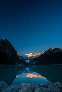 de-preciated:  Lake Louise Sunrise & Moonset (by Old-Man-George) I took these on our last morning in the Rockies. We had a long drive back to Vancouver that day, and I made it even longer by getting up before sunrise for these shots. Totally worth it though! Not sure what caused the banding in the sky here. It wasn't noticeable in Lightroom. Maybe a dodgy jpg export. Sorry about that.