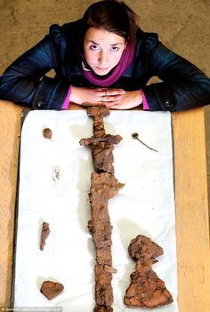 Archaeologist Helena Gray with the sword and other artefacts from a Viking Ship burial at Ardnamurchan, Scotland.