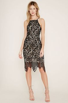 This woven dress is crafted from floral eyelash lace with adjustable cami straps, a square neckline, a scalloped hem, and an exposed back zipper.