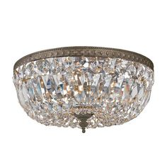 The vibrant style of this crystal light is paired perfectly with a classic and subtle shape, allowing this piece to act as both a centerpiece oand room accent. Create a unique atmosphere in your home by adding this versatile room light to your decor.