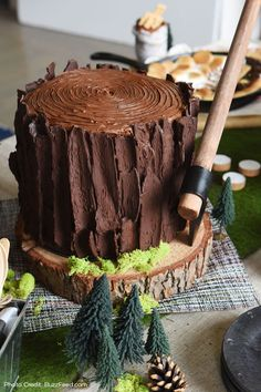 Rustic cake ideas. Perfect for the couple that loves the outdoors, this BuzzFeed party features wood slab, moss table runners, faux succulents and more from Afloral.com.  http://bzfd.it/1Lpq1lw