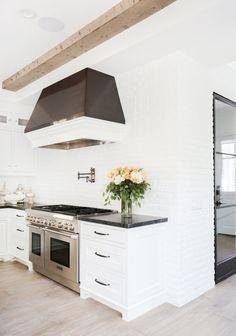 Modern + spacious white kitchen: http://www.stylemepretty.com/living/2016/07/25/30-dream-kitchen-moments-thatll-make-you-want-to-renovate/