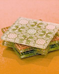 Instead of buying fancy coasters, decorate inexpensive glass coasters from outlet stores with scraps of your favorite paper.
