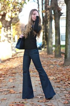 #fashion #fashionista Laura |  simple black sweater and flares, long wavy hair, black bag and shoes
