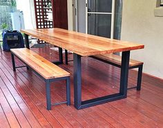 Recycled timber dining table, Australian hardwood, messmate eucalyptus, with industrial fabricated steel hoop legs and optional bench seats