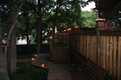 Deck lights using low voltage lighted post caps, under railing LED lights, and step lights.