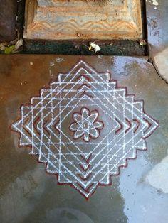 Chittaara for tulasi. Rangoli Borders, Rangoli Patterns, Rangoli Ideas, Kolam Rangoli, Flower Rangoli, Padi Kolam, Indian Rangoli Designs, Rangoli Border Designs, Rangoli Designs Images