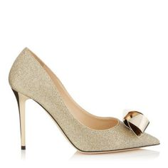 Vesna 100, Jimmy Choo, Fall 2015. $975, Gold Lamé Glitter Pointy Toe Pumps With Gold Metal Knot Detail. Buy it here: http://justbestylish.com/12-best-pairs-of-shoes-jimmy-choo-fall-2015/7/