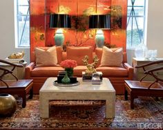 Asian-inspired living room with orange Chinoiserie folding screen. Photo from Elle Decor