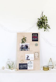 diy christmas card display with ornaments and greenery